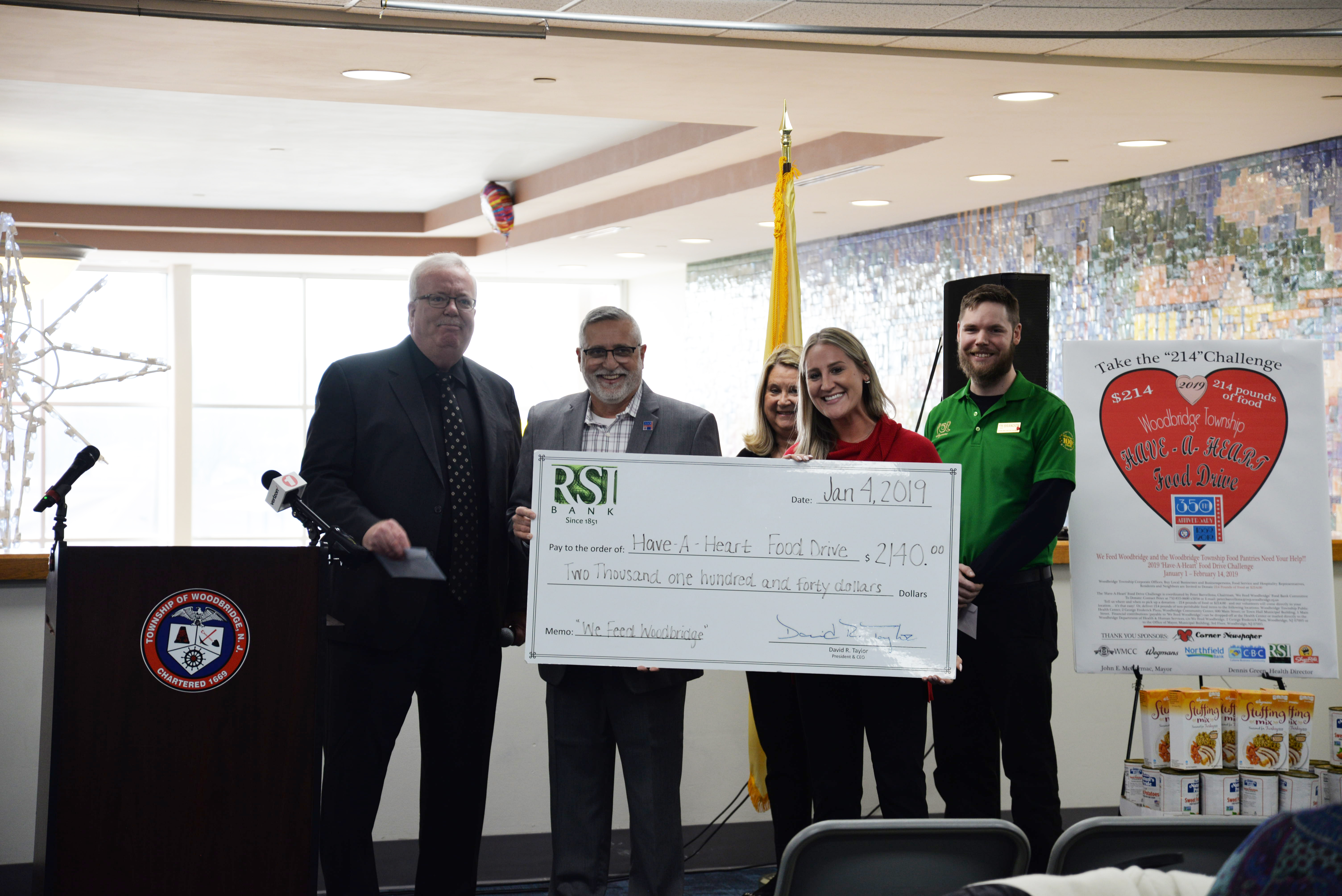 Woodbridge Mayor John E. McCormac accepts the donation check from RSI Bank. Standing to the right of Mayor McCormac are Peter Barcellona, Karen Barnes, and Amy Krysienski, RSI Bank's Business Development Officer for the Woodbridge area.