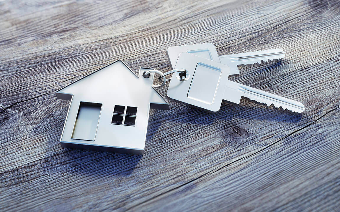 A set of house keys with a house shaped key tag